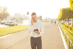 Businessman with mobile phone tablet in hands royalty free stock photography
