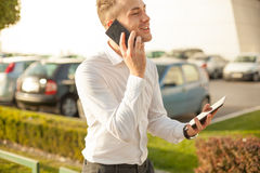Businessman with mobile phone tablet in hands stock images