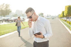 Businessman with mobile phone tablet in hands royalty free stock photo