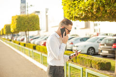 Businessman with mobile phone and tablet in hands royalty free stock photos