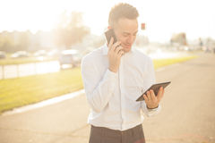 Businessman with mobile phone tablet in hands Royalty Free Stock Photos