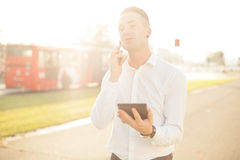 Businessman with mobile phone tablet in hands stock photo