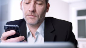 Businessman with  mobile phone stock video footage