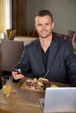 Businessman With Mobilephone And Laptop Having Royalty Free Stock Images