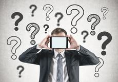 Businessman with mock up tablet, question marks Royalty Free Stock Photography
