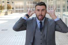Businessman mocking someone at the office royalty free stock images
