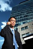 Businessman and modern building. Businessman make phone call in front of modern building Royalty Free Stock Photos