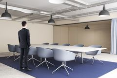 Businessman in modern conference room royalty free stock photo
