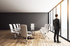 Businessman in modern conference room. Thoughtful young businessman standing in modern conference room interior with panoramic city view, furniture and daylight stock illustration