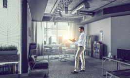 Businessman in modern interior   . Mixed media Royalty Free Stock Photos