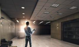 Businessman in modern interior  . Mixed media Stock Photos