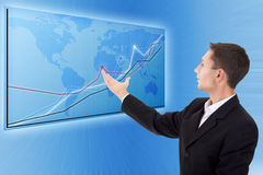 Businessman and a modern map with charts Royalty Free Stock Photo