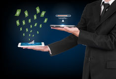 Businessman with modern mobile phone. Uploading data and money flting out in his hand royalty free stock photography