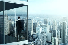 Businessman in the modern office building Stock Photos