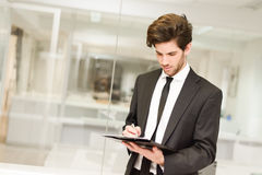 Businessman in modern office Stock Photography
