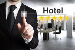 Businessman in modern office pushing touchscreen hotel rating five stars. Businessman in modern office pushing touchscreen hotel rating stars royalty free stock photos