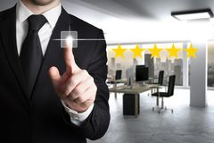 Businessman in modern office pushing virtual button four star review 3D Illustration. Businessman in large modern office pushing virtual button four star review stock photo