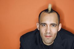 Businessman with mohawk. Stock Photos