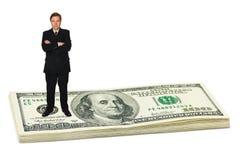 Businessman on money. Isolated on white background royalty free stock photos