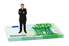 Businessman on money Stock Photo