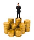 Businessman on money. Stacks isolated on white background stock photography