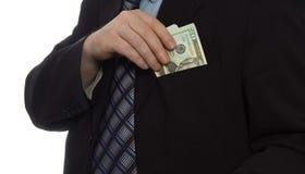 Businessman money. Businessman put money into pocket stock photo