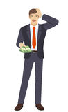 Businessman with money grabbed his head Stock Photos