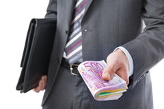 Businessman with money in hand Stock Image