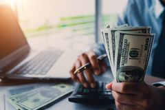 Businessman with money in hand stock photos