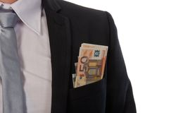 Businessman with money in his pocket Stock Images