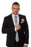 Businessman with money in his pocket Royalty Free Stock Images