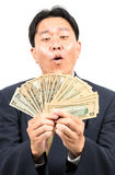 Businessman with money Stock Images