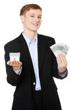 Businessman with money and house's model. Stock Image
