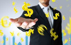 Businessman with a money icon. Floating in the air Stock Photo