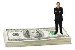 Businessman on money. Isolated on white background stock images