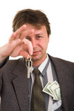 Businessman with money and key Stock Image