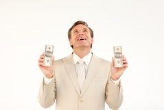 Businessman with money looking upwards Stock Photo