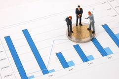 Businessman and money over a chart Royalty Free Stock Photos
