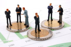 Businessman and money over a chart Stock Photography