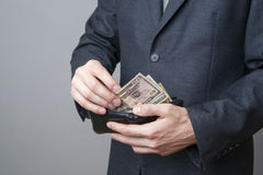 Businessman with money in purse in hands Royalty Free Stock Photo