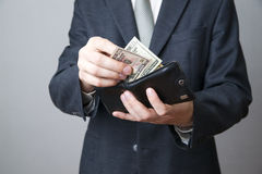 Businessman with money in purse in hands Stock Image
