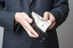 Businessman with money in purse in hands Royalty Free Stock Photography