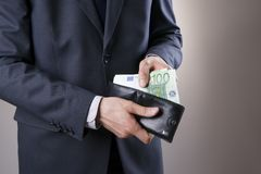 Businessman with money in purse in hands Royalty Free Stock Photos