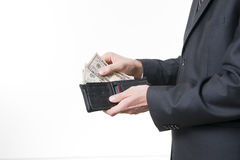 Businessman with money in purse in hands Royalty Free Stock Image