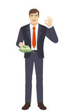 Businessman with money show a okay hand sign Stock Photography