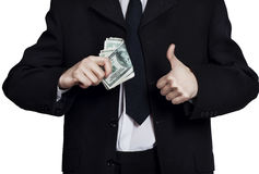 Businessman with money showing hand ok sign Royalty Free Stock Photo