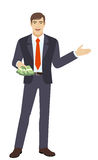 Businessman with money showing something beside of him Stock Image