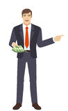 Businessman with money showing somewhere Royalty Free Stock Image