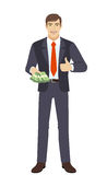 Businessman with money shows thumb up Stock Photography