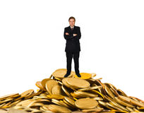 Businessman on money. Stacks isolated on white background royalty free stock photos